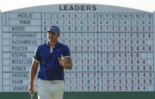 (AP Photo/Charlie Riedel). Brooks Koepka walks on the 17th hole during the first round for the Masters golf tournament Thursday, April 11, 2019, in Augusta, Ga.