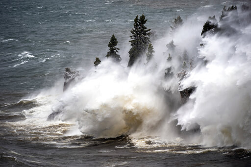 (Brian Peterson/Star Tribune via AP). Waves pound the shoreline at Tettegouche State Park Thursday, April 11, 2019 at Silver Bay, Minn. Wind gusts were up to 50 milers per hour.