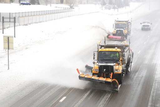 (Briana Sanchez/The Argus Leader via AP). Snow plows clear Interstate 29 on Thursday, April 11, in Sioux Falls, S.D. Heavy snow and strong winds hammered parts of the central U.S. on Thursday, knocking out power to tens of thousands of people and creat...