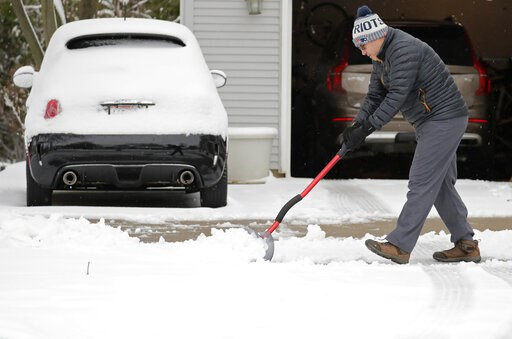 (Dan Powers/The Post-Crescent via AP). Miguel Leiva shovels his driveway along N. Racine Street during a spring snow storm Thursday, April 11, 2019, in Appleton, Wis.  The second major snowstorm in the region in a month left behind hazardous road condi...