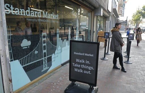 (AP Photo/Eric Risberg, File). FILE - This Nov. 14, 2018, file photo shows the Standard Cognition cashier-less store on Market Street in San Francisco. A small number of restaurants and stores are going cash-free in the U.S., looking to cater to custom...