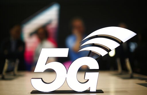 (AP Photo/Manu Fernandez, File). FILE - This Feb. 25, 2019 file photo shows a banner of the 5G network is displayed during the Mobile World Congress wireless show, in Barcelona, Spain.  The U.S. communications regulator will hold a massive auction to b...