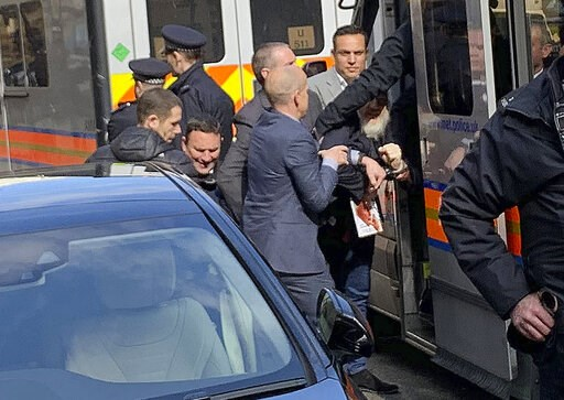 (@DailyDOOH via AP). Police bundle WikiLeaks founder Julian Assange from the Ecuadorian embassy into a police van in London after he was arrested by officers from the Metropolitan Police and taken into custody Thursday April 11, 2019. Police in London ...
