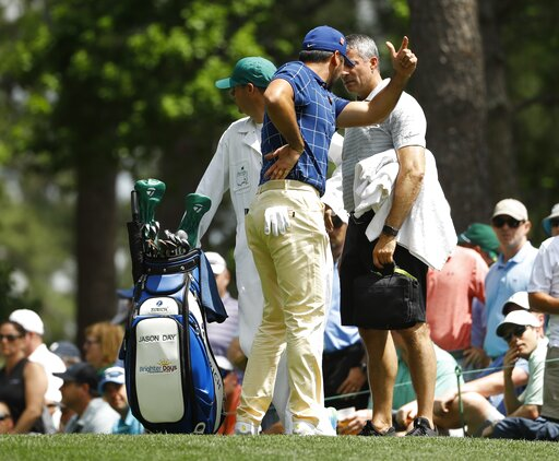 (AP Photo/Matt Slocum). Jason Day, of Australia, holds his back on the fourth tee during the first round for the Masters golf tournament Thursday, April 11, 2019, in Augusta, Ga.
