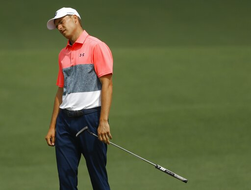 (AP Photo/Matt Slocum). Jordan Spieth reacts after a missed putt on the second hole during the second round for the Masters golf tournament Friday, April 12, 2019, in Augusta, Ga.