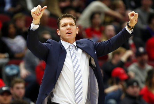 (AP Photo/Nuccio DiNuzzo,File). FILE - In this March 12, 2019, file photo, Los Angeles Lakers coach Luke Walton gestures to players during the second half of an NBA basketball game against the Chicago Bulls in Chicago. The Lakers say they have mutually...