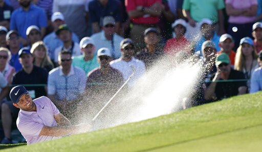 (AP Photo/David J. Phillip). Francesco Molinari, of Italy, hits from a bunker on the 18th hole during the third round for the Masters golf tournament Saturday, April 13, 2019, in Augusta, Ga.