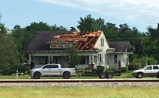 (Laura McKenzie/College Station Eagle via AP). A roof is torn off a home following a suspected tornado, Saturday, April 13, 2019 in Franklin, Texas.