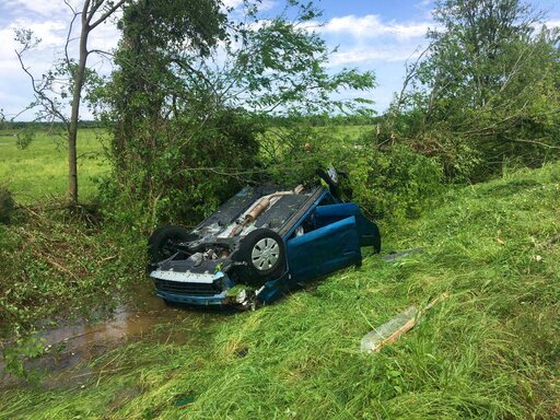 (Laura McKenzie/College Station Eagle via AP). A car lies upside down in a ditch following a suspected tornado, Saturday, April 13, 2019 in Franklin, Texas.