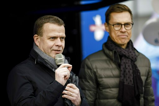 (Seppo Samuli/Lehtikuva via AP). The chairman of the National Coalition Party and parliamentary candidate Petteri Orpo, left, with Vice President of European Investment Bank Alexander Stubb campaign for parliamentary elections in Helsinki, Finland, on ...