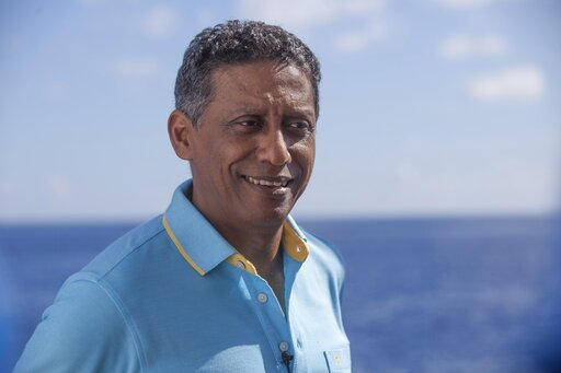(AP Photo/Steve Barker). In this Saturday, April 13, 2019, photo, Seychelles President Danny Faure smiles during an interview with the Associated Press, on board the vessel Ocean Zephyr off the coast of Desroches, in the outer islands of Seychelles. Pr...