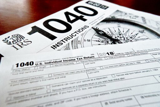 (AP Photo/Keith Srakocic, File). FILE- This Feb. 13, 2019, file photo shows multiple forms printed from the Internal Revenue Service web page that are used for 2018 U.S. federal tax returns in Zelienople, Pa. If you don't think you will be able to comp...