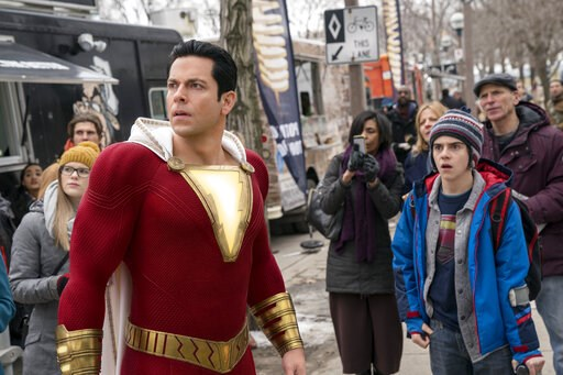 "(Steve Wilkie/Warner Bros. Entertainment via AP). This image released by Warner Bros. shows Zachary Levi, left, and Jack Dylan Grazer in a scene from ""Shazam!"""