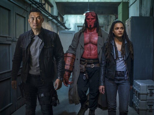 "(Mark Rogers/Lionsgate via AP). This image released by Lionsgate shows, from left, Daniel Dae Kim, David Harbour and Sasha Lane in a scene from ""Hellboy."""