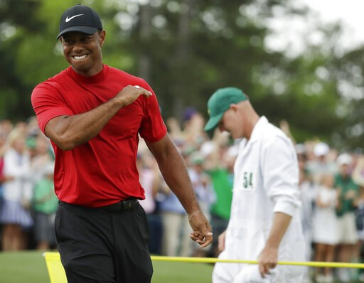 (AP Photo/Chris Carlson). Tiger Woods reacts as he wins the Masters golf tournament Sunday, April 14, 2019, in Augusta, Ga.