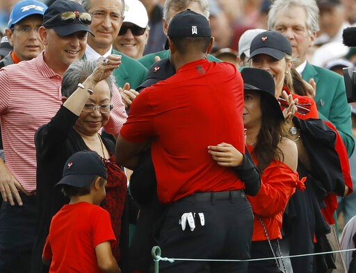 (AP Photo/Matt Slocum). Tiger Woods hugs his family after winning the Masters golf tournament Sunday, April 14, 2019, in Augusta, Ga.