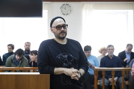 (AP Photo/Pavel Golovkin). Russian theatre and film director Kirill Serebrennikov, center, waits a court hearing in Moscow, Russia, Monday, April 8, 2019. The Moscow City Court on Monday overturned a district court's decision to extend house arrest for...