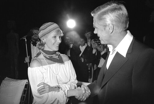 "(AP Photo/Jean-Jacques Levy, File). FILE - In this May 25, 1978 file photo, Swedish actress Bibi Andersson meets George Peppard at a party for the announcement of start of new U.S. film ""Cabo Blanco"". Sweden's Film Institute says Bibi Andersson, the Sw..."