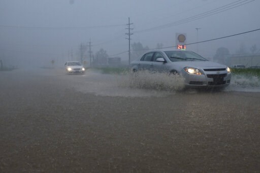 (Courtland Wells/The Vicksburg Post via AP). Vehicles travel through a flooded section of Highway 61 South following severe weather on Saturday, April 13, 2019 in Vicksburg, Miss. Authorities say a possible tornado has touched down in western Mississip...