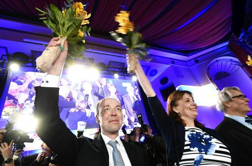 (Vesa Moilanen/Lehtikuva via AP). Chairman of The Finns Party Jussi Halla-aho, left, Party Secretary Riikka Slunga-Poutsalo and Campaign manager Ossi Sandvik, right, attend The Finns Party parliamentary election party in Helsinki, Finland on Sunday, Ap...