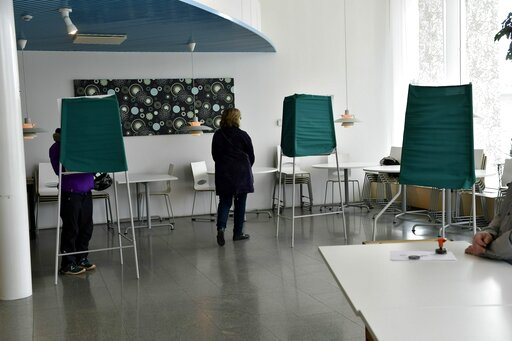 (Emmi Korhonen/Lehtikuva via AP). Citizens cast their votes during Finnish parliamentary elections, at the town hall in Manstala, Finland on Sunday, 14th April, 2019. Finns went to the polls in parliamentary elections on Sunday.