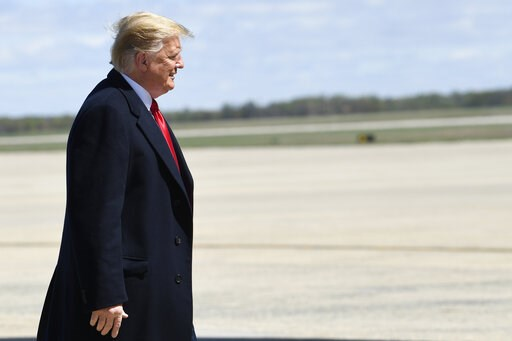 (AP Photo/Susan Walsh). President Donald Trump walks towards the steps of Air Force One at Andrews Air Force Base in Md., Monday, April 15, 2019. Trump is heading to Minnesota for a tax day event.