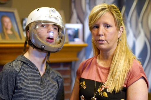 (AP Photo/Nati Harnik). In this April 11, 2019 photo, Shelley Gillen is photographed in her Bellevue, Neb., home with her 17-year-old son, Will, who wears a helmet to protect him from damage during debilitating seizures. Gillen advocates the legalizati...