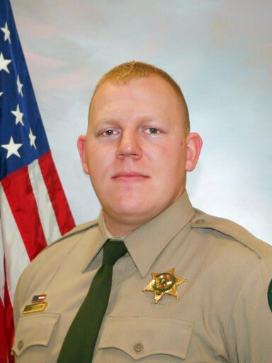 (Cowlitz County Sheriff's Office/The Columbian via AP). Cowlitz County Sheriff's Office Deputy Justin DeRosier, 29, was shot and killed Saturday, April 13, 2019, while checking on a disabled vehicle northeast of Kalama, Wa..