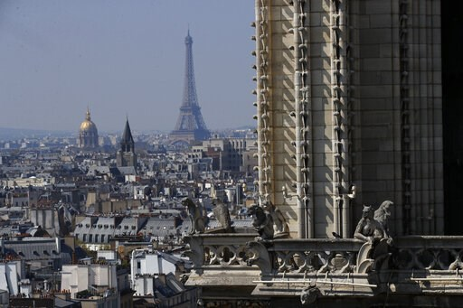 (AP Photo/Francois Mori). View from the top of the Paris' Notre Dame Cathedral with the Eiffel Tower in background as the religious statues descend to earth for the first time in over a century as part of a restoration, in Paris Thursday, April 11, 201...