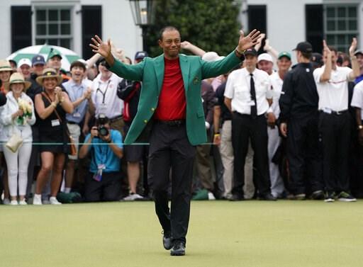 (AP Photo/David J. Phillip). Tiger Woods celebrates after he won the Masters golf tournament Sunday, April 14, 2019, in Augusta, Ga.