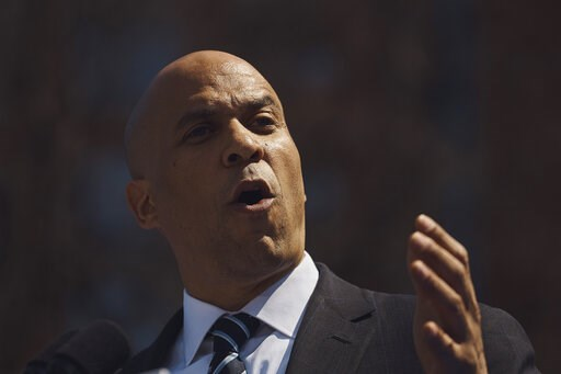 (AP Photo/Andres Kudacki). Democratic presidential candidate Sen. Cory Booker, D-N.J. talks to the crowd during a hometown kickoff for his national presidential campaign tour at Military Park in downtown Newark, Saturday, April 13, 2019.