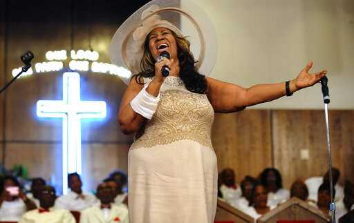 (Elizabeth Conley/The Detroit News via AP, File). FILE - In this June 7, 2015 file photo, Aretha Franklin sings during a memorial service for her father and brother, Rev. C.L. and Rev. Cecil Franklin, at New Bethel Baptist Church where they were minist...