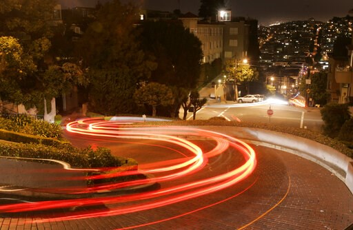 (AP Photo/Marcio Jose Sanchez, File). FILE - In this April 28, 2008 file photo, motorists wind their way down Lombard Street in San Francisco. Tourists may soon have to pay a fee to drive down San Francisco's world-famous crooked street. California off...