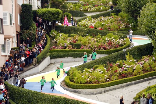 (AP Photo/Marcio Jose Sanchez, File). FILE - In this Aug. 19, 2009 file photo, children run down Lombard Street in San Francisco, transformed for the day into a gigantic Candy Land board game to commemorate the game's 60th anniversary. Tourists may soo...
