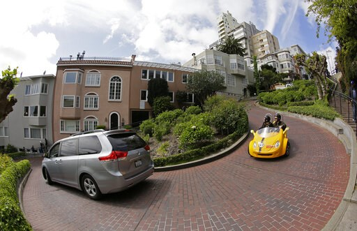 (AP Photo/Eric Risberg). Cars make their way down Lombard Street in San Francisco, Monday, April 15, 2019. Thousands of tourists may soon have to pay as much as $10 to drive down the world-famous crooked street if a proposal announced Monday becomes la...