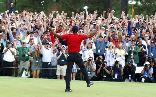 (Curtis Compton/Atlanta Journal-Constitution via AP). Tiger Woods reacts as he wins the Masters golf tournament Sunday, April 14, 2019, in Augusta, Ga.