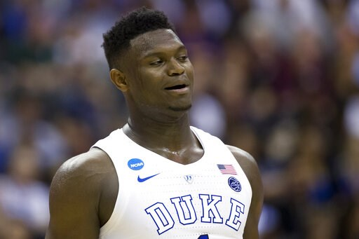 (AP Photo/Alex Brandon, File). FILE - In this March 29, 2019, file photo, Duke forward Zion Williamson (1) reacts during an East Regional semifinal in the NCAA men's basketball tournamenet against Virginia Tech in Washington. Williamson was named the J...