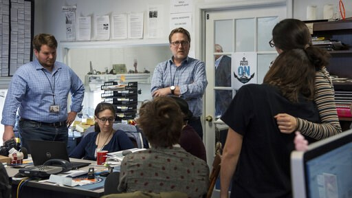 (Ulysses Muoz/The Baltimore Sun via AP). Editor Rick Hutzell, center, gives a speech to his staff including Chase Cook, Nicki Catterlin, Rachael Pacella, Selene San Felice and Danielle Ohl at the Capital Gazette in Annapolis, Md., Monday, April 15, 201...