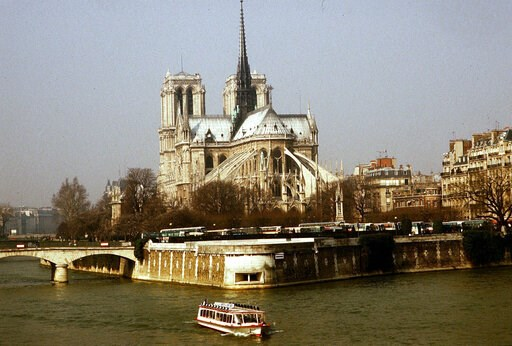 (AP Photo/Lionel Cironneau, File). FILE - This 1987 file photo shows the Notre Dame Cathedral in Paris. Art experts around the world reacted with horror to news of the fire that ravaged cathedral on Monday, April 15, 2019. One shell-shocked art expert ...
