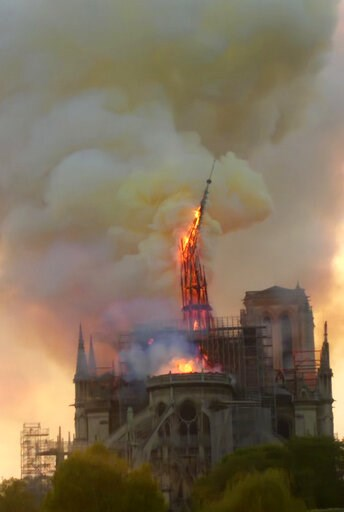 (AP Photo/Dominique Bichon). Flames and smoke rise as the spire of Notre Dame cathedral collapses in Paris, Monday, April 15, 2019. A catastrophic fire engulfed the upper reaches of Paris' soaring Notre Dame Cathedral as it was undergoing renovations M...