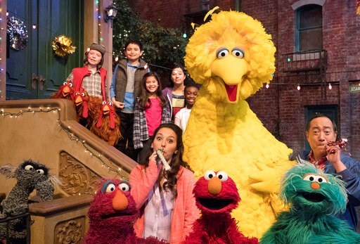 "(HBO via AP). This image released by HBO shows the cast of the popular children's show ""Sesame Street."" Big Bird, Elmo and stars of ""Sesame Street"" are leaving their quiet neighborhood and hitting the road. The non-profit Sesame Workshop said Tuesday a..."