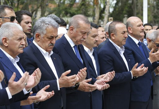 (Presidential Press Service via AP, Pool). Turkey's President Recep Tayyip Erdogan, third left, his party's mayoral candidate for Istanbul Binali Yildirim, left, his ministers Bekir Pakdemirli, third right, Mevlut Cavusoglu, second right, and Suleyman ...