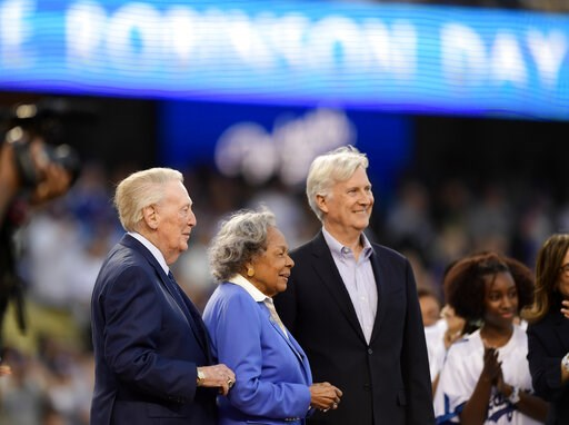 (AP Photo/Mark J. Terrill). Former Los Angeles Dodgers broadcaster Vin Scully, left, stands with Jackie Robinson's widow Rachel Robinson, center, and Dodgers co-owner Mark Walter prior to a baseball game between the Dodgers and the Cincinnati Reds, Mon...