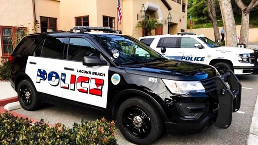 (Laguna Beach Police Department via AP). This undated photo provided by the Laguna Beach Police Department shows their newly decorated Police SUV patrol vehicles in Laguna Beach, Calif. An American flag graphic on the side of freshly painted police car...