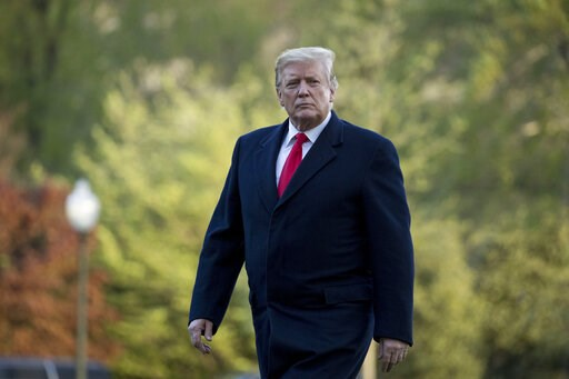 (AP Photo/Andrew Harnik). President Donald Trump walks on the South Lawn as he arrives at the White House in Washington, Monday, April 15, 2019, after visiting Minnesota.