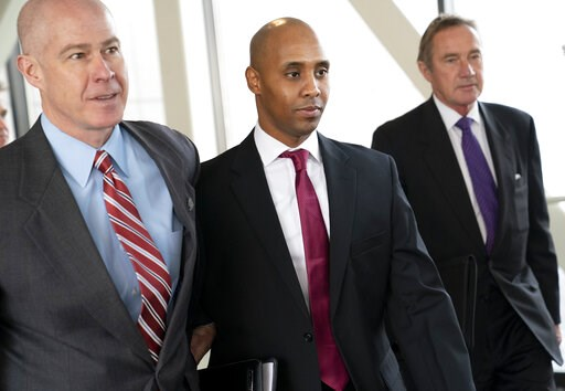(Renee Jones Schneider/Star Tribune via AP, File). FILE--In this April 1, 2019, file photo, former Minneapolis police officer Mohamed Noor, center, leaves the Hennepin County Government Center after the first day of jury selection with his attorneys Th...