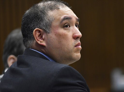 (Clarence Tabb Jr./Detroit News via AP). Former Michigan state trooper Mark Bessner listens to Assistant Wayne County Prosecutor Matthew Penney delivers his opening argument in Bessner's trial, Wednesday, April 10, 2019, Detroit. Bessner is charged wit...