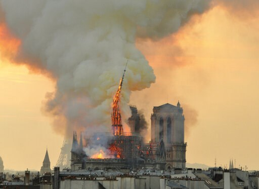 (AP Photo/Thierry Mallet). In this image made available on Tuesday April 16, 2019 flames and smoke rise from the blaze as the spire starts to topple on Notre Dame cathedral in Paris, Monday, April 15, 2019. An inferno that raged through Notre Dame Cath...