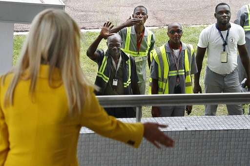 (AP Photo/Jacquelyn Martin). U.S. White House senior adviser Ivanka Trump, left, waves back at airport workers as one blows a kiss and others wave as she arrives at the airport in Abidjan, Ivory Coast, Tuesday April 16, 2019, after flying in from Ethio...