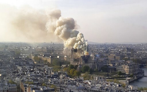 (AP Photo/Cedric Herpson). In this image made available on Tuesday April 16, 2019 flames and smoke rise from the blaze at Notre Dame cathedral in Paris, Monday, April 15, 2019. An inferno that raged through Notre Dame Cathedral for more than 12 hours d...